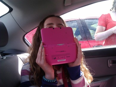 meabh, hiding from the camera with my ds